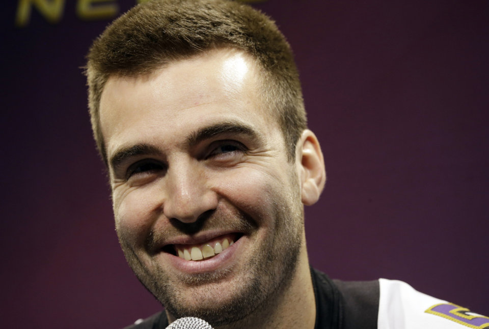Photo - Baltimore Ravens quarterback Joe Flacco smiles during media day for the NFL Super Bowl XLVII football game Tuesday, Jan. 29, 2013, in New Orleans. (AP Photo/Pat Semansky)
