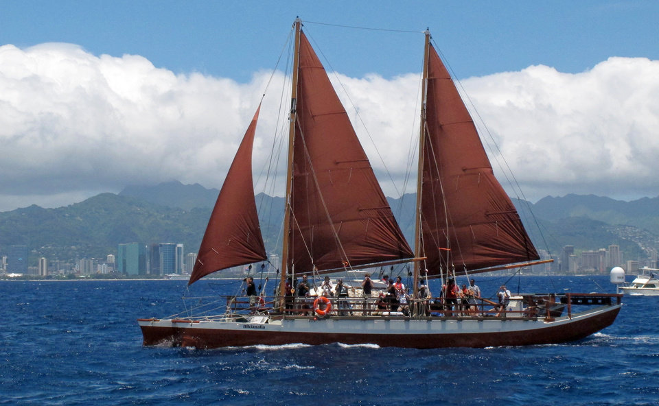 Photo - The Hikianalia sailing canoe is seen off Honolulu Tuesday, April 29, 2014.The modern sister vessel plans to accompany the Hokulea, a Polynesian voyaging canoe, on a 3-year voyage around the world, navigating using no modern instrumentation. (AP Photo/Oskar Garcia)