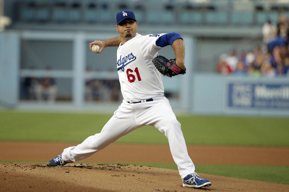 Photo - Los Angeles Dodgers starting pitcher Josh Beckett throws against the Atlanta Braves during the first inning of a baseball game on Tuesday, July 29, 2014, in Los Angeles. (AP Photo/Jae C. Hong)