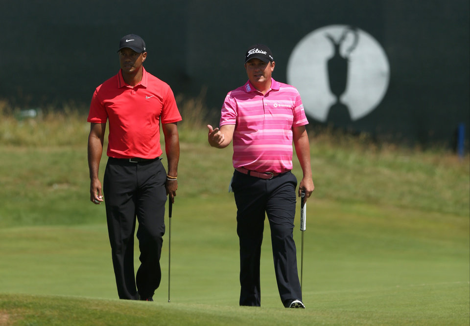 Photo - Tiger Woods of the US and Jason Dufner of the US, right, walk along the 15th green during the final round of the British Open Golf championship at the Royal Liverpool golf club, Hoylake, England, Sunday July 20, 2014. (AP Photo/Jon Super)