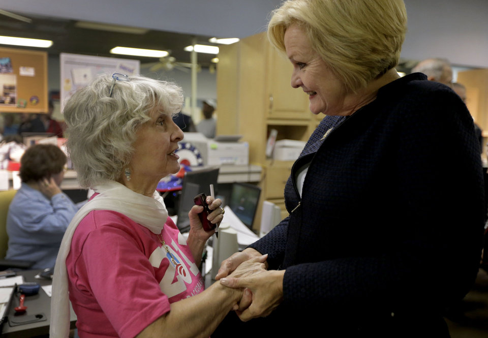 Photo -   Democratic Sen. Claire McCaskill talks Evelyn Childers at Clay County Democratic headquarters Monday, Nov. 5, 2012, in Kansas City, Mo. McCaskill is running against Republican Todd Akin for Missouri's Senate seat. (AP Photo/Charlie Riedel)