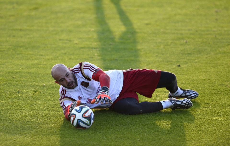Photo - Spain's goalkeeper Pepe Reina saves a ball during a training session at he Atletico Paranaense training center in Curitiba, Brazil, Saturday, June 14, 2014. Spain will play in group B of the Brazil 2014 World Cup. (AP Photo/Manu Fernandez)
