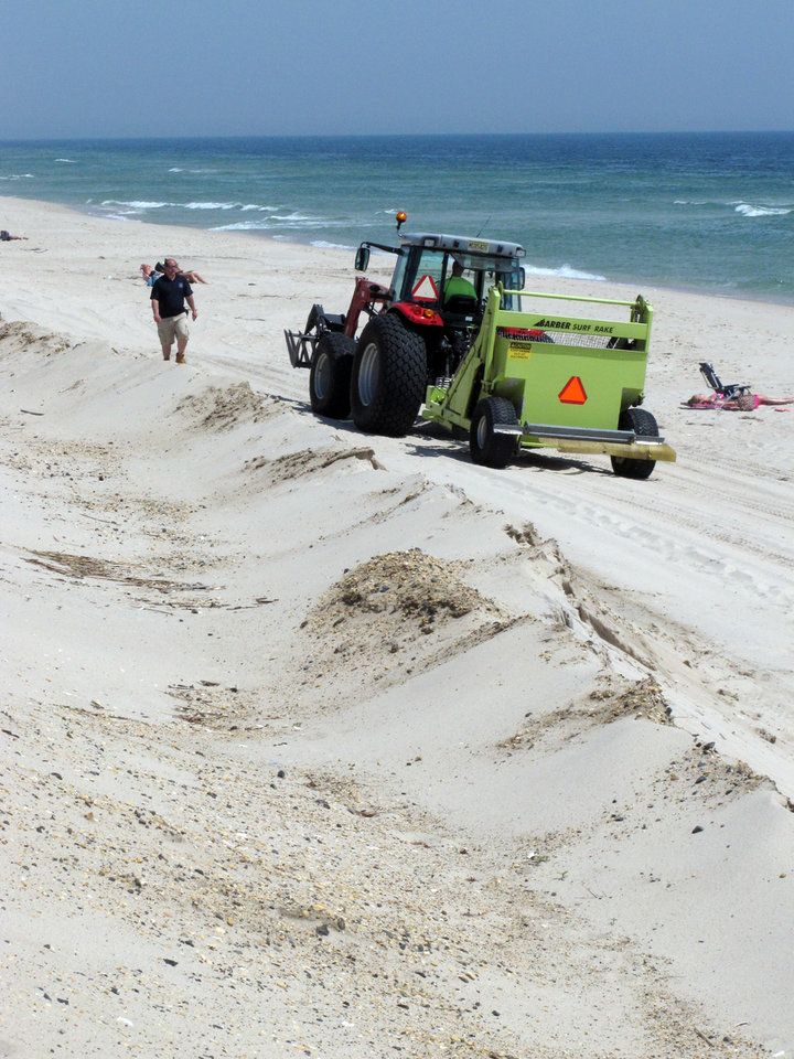 Photo - In this May 12, 2014 photo, a beach sweeper cleans the sand in the Ortley Beach section of Toms River N.J. Experts say most of the Jersey shore's beaches came through the winter in fine shape, and are in their best condition in years as the second summer after Superstorm Sandy approaches. (AP Photo/Wayne Parry)