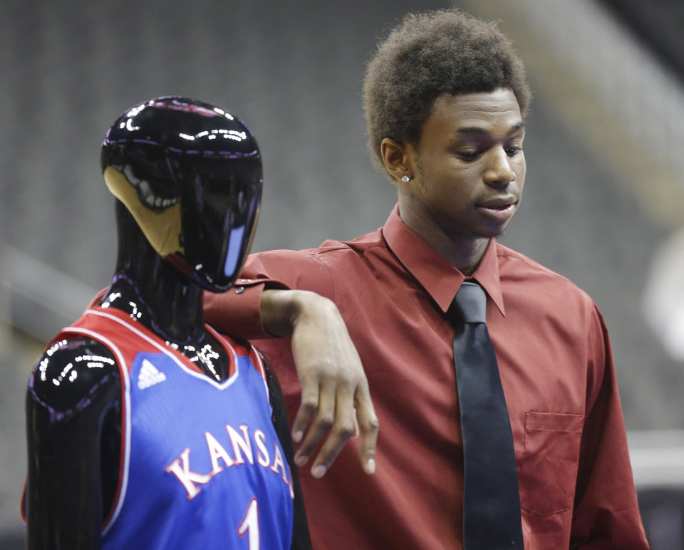 Photo - Kansas guard Andrew Wiggins stands next to a mannequin in a KUansas University uniform during Big 12 NCAA college basketball media day in Kansas City, Mo., Tuesday, Oct. 22, 2013. (AP Photo/Orlin Wagner)