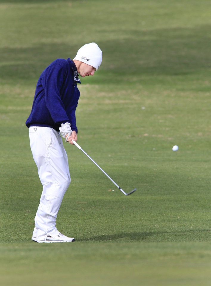Photo - Daniel Echevarria, Cascia Hall, chips onto the green during the Class 4A boys golf at Lake Hefner Golf Course, Tuesday May 13, 2014.  Photo by David McDaniel, The Oklahoman