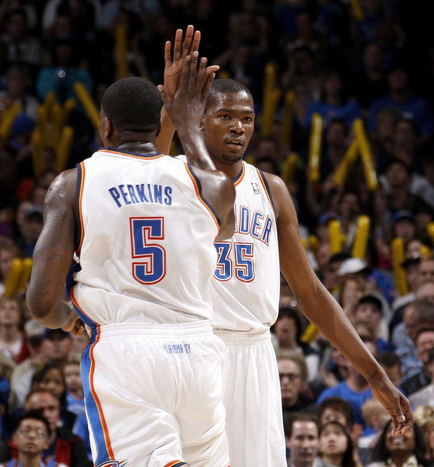 Photo - Oklahoma City's Kevin Durant (35) celebrates with Kendrick Perkins (5) during the NBA basketball game between the Oklahoma City Thunder and the Charlotte Bobcats at the Oklahoma City Arena, Friday, March 18, 2011. Photo by Bryan Terry, The Oklahoman