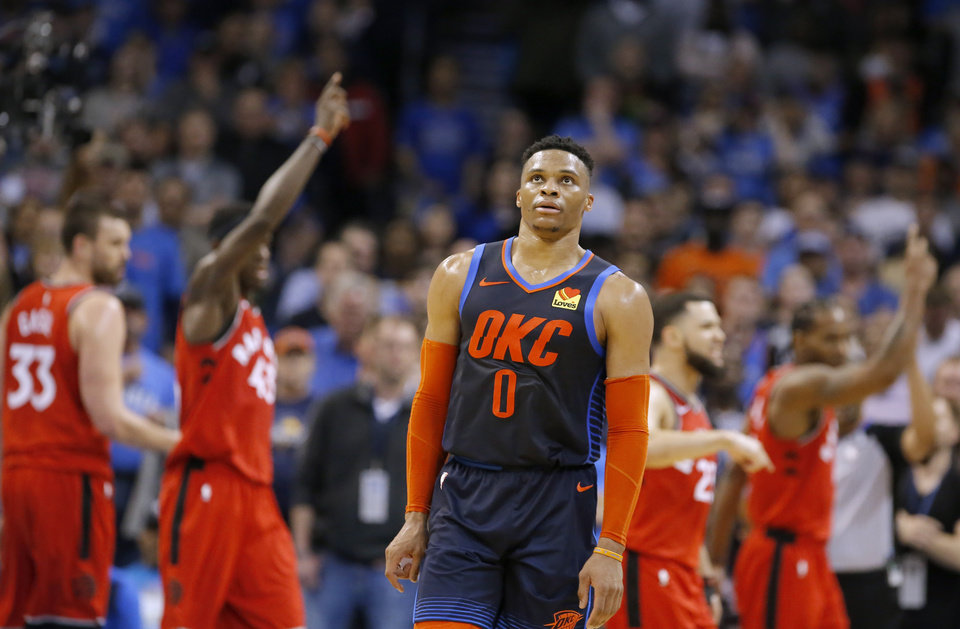 Photo - Oklahoma City's Russell Westbrook (0) reacts during overtime during the NBA basketball game between the Oklahoma City Thunder and the Toronto Raptors at the Chesapeake Energy Arena, Wednesday,March 20, 2019. Photo by Sarah Phipps, The Oklahoman