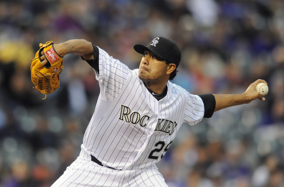 Photo - Colorado Rockies starting pitcher Jorge De La Rosa throws in the first inning of a baseball game against the Arizona Diamondbacks on Saturday, April 5, 2014, in Denver. (AP Photo/Chris Schneider)