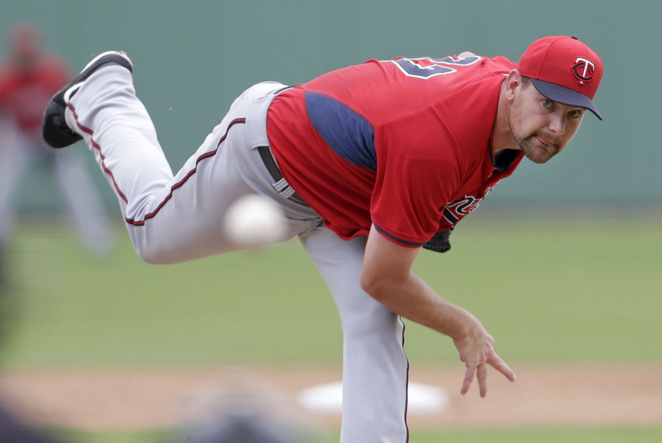 Photo - Minnesota Twins starting pitcher Mike Pelfrey pitches during the first inning of an exhibition baseball game against the Boston Red Sox in Fort Myers, Fla., Saturday, March 29, 2014. (AP Photo/Gerald Herbert)