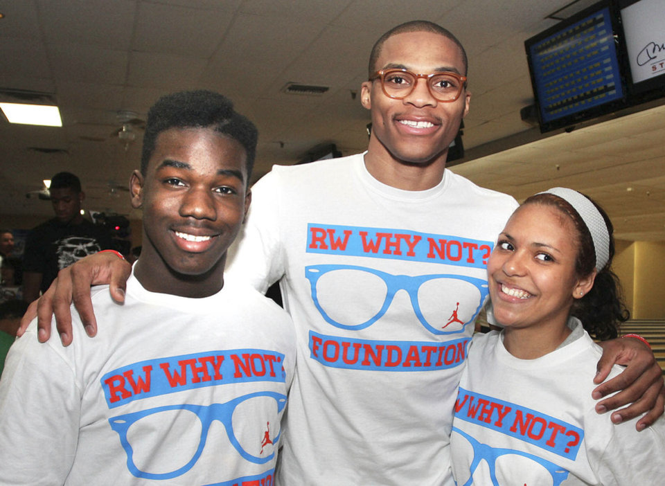 Xavier Wilson, Russell Westbrook, Jessica  Caldwell. PHOTOS BY DAVID FAYTINGER, FOR THE OKLAHOMAN