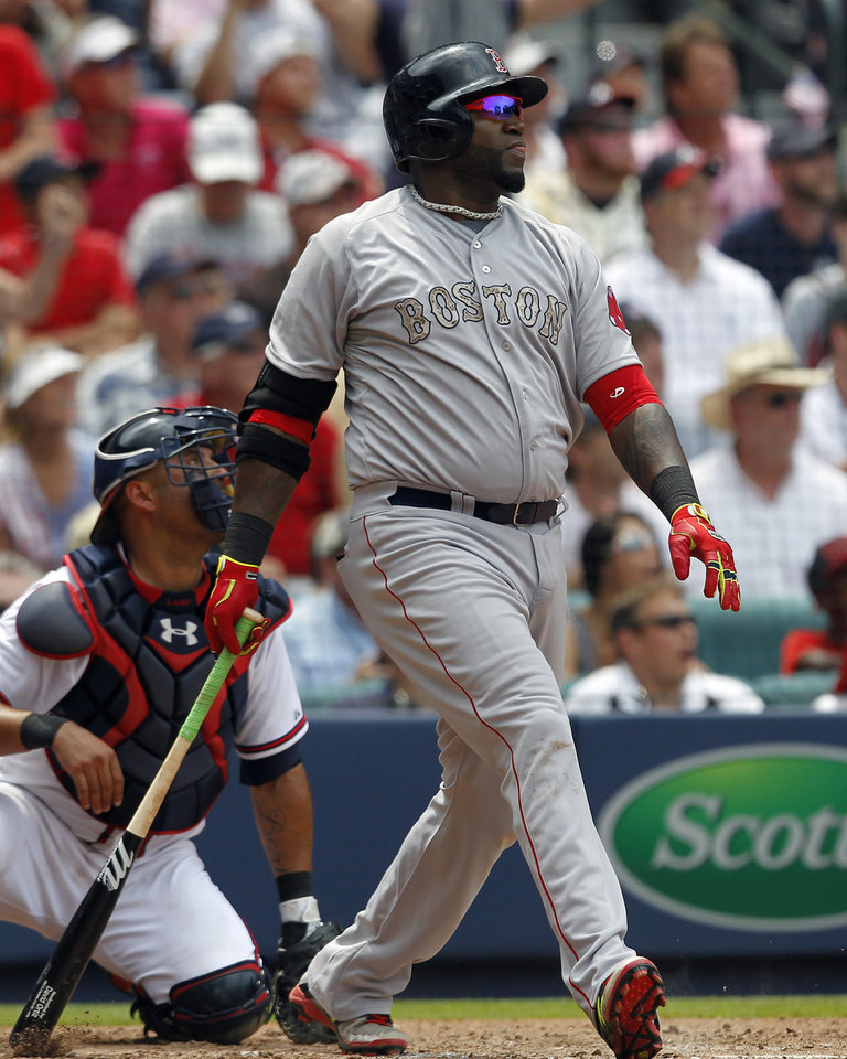 Photo - Boston Red Sox's David Ortiz (34) watches his three run homer during the fifth inning of a baseball game against the Atlanta Braves on Monday, May 26, 2014, in Atlanta, Ga. (AP Photo/Butch Dill)