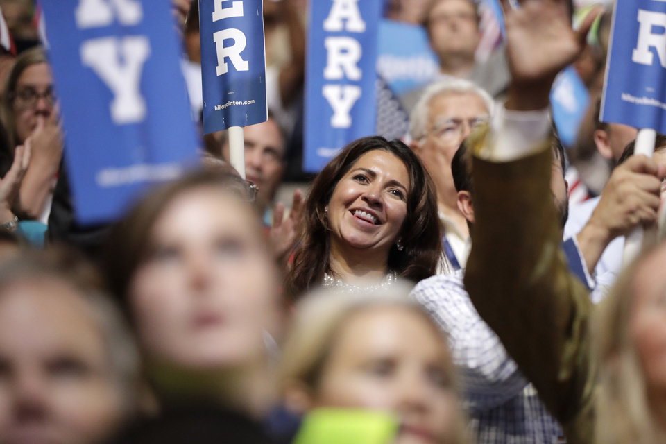 Photo - Supporters watch as Democratic presidential nominee Hillary Clinton speaks during the final day of the Democratic National Convention in Philadelphia, Thursday, July 28, 2016. (AP Photo/Matt Rourke)