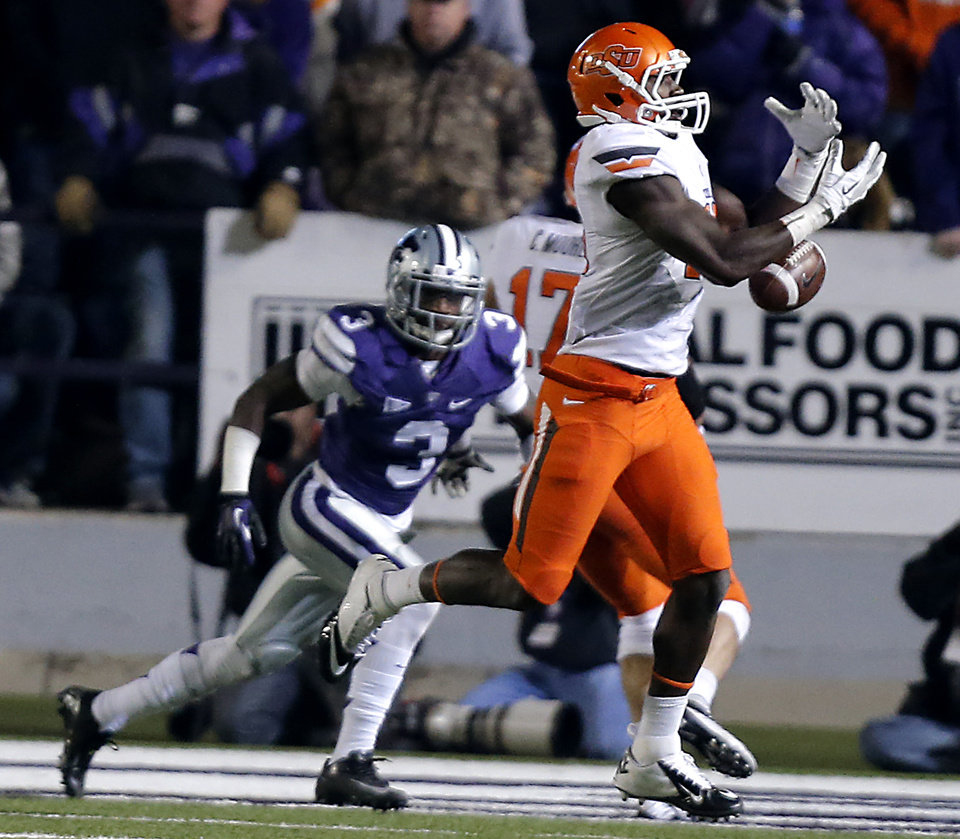 Photo - Oklahoma State's Blake Jackson (18) drops a pass during the college football game between the Oklahoma State University Cowboys (OSU) and the Kansas State University Wildcats (KSU) at Bill Snyder Family Football Stadium on Saturday, Nov. 1, 2012, in Manhattan, Kan. Photo by Chris Landsberger, The Oklahoman