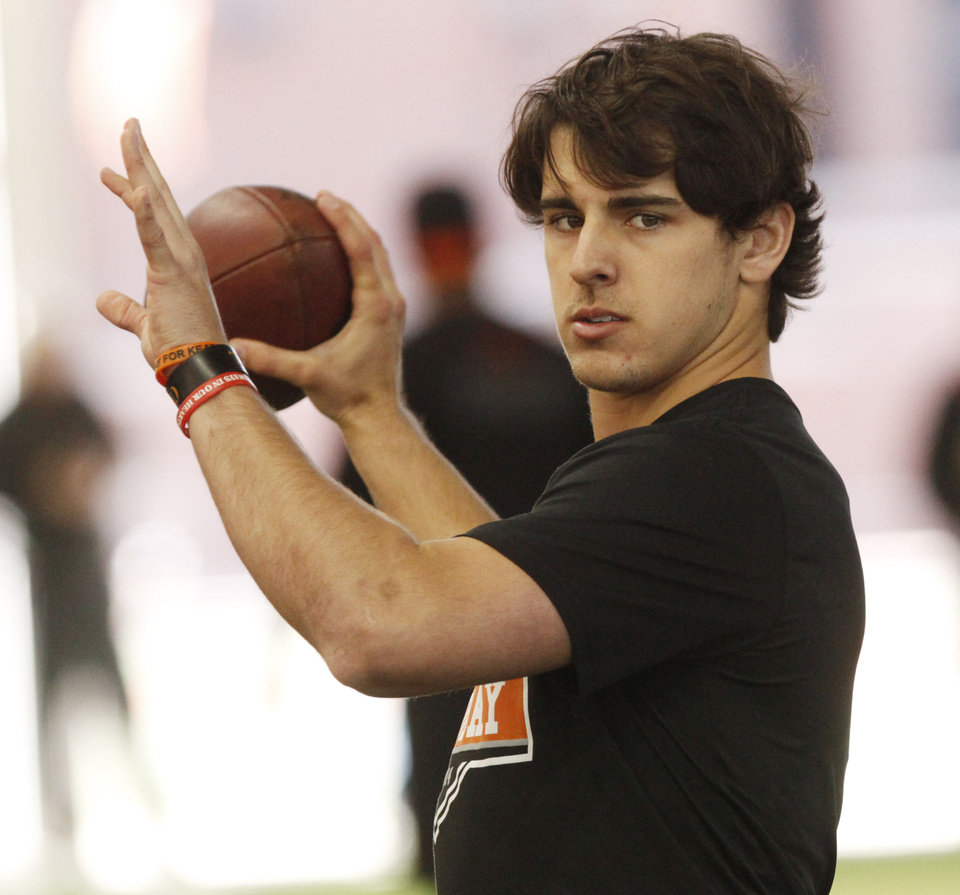 Photo - Quarterback Clint Chelf prepares to throw during a workout at Oklahoma State's pro day held at Boone Pickens Stadium in Stillwater on Thursday, March 13, 2014. Photo by KT King, The Oklahoman
