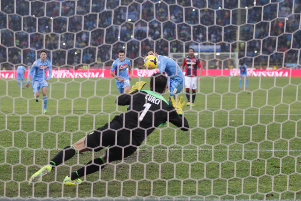 Photo - Napoli's Gonzalo Higuain scores on a penalty during the Serie A soccer match between Bologna and Napoli at Renato Dall' Ara stadium in Bologna, Italy, Sunday, Jan.19, 2014. (AP Photo/Studio FN)