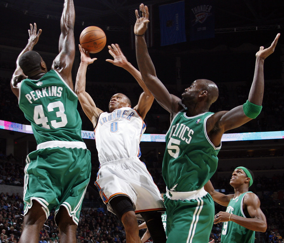 Oklahoma City's Russell Westbrook takes a shot between Kendrick Perkins (43) and Kevin Garnett (5) of Boston as Rajon Rondo (9) looks on in the first half of the NBA basketball game between the Boston Celtics and the Oklahoma City Thunder at the Ford Center in Oklahoma City, Friday, Dec. 4, 2009. Photo by Nate Billings, The Oklahoman ORG XMIT: KOD