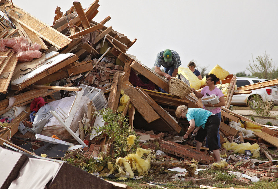 Photo - Neighbors pitch in to help recover items out of the home of Scott and M'Lynn McCann's home that was destroyed by a tornado west of El Reno, Tuesday, May 24, 2011. Photo by Chris Landsberger, The Oklahoman ORG XMIT: KOD