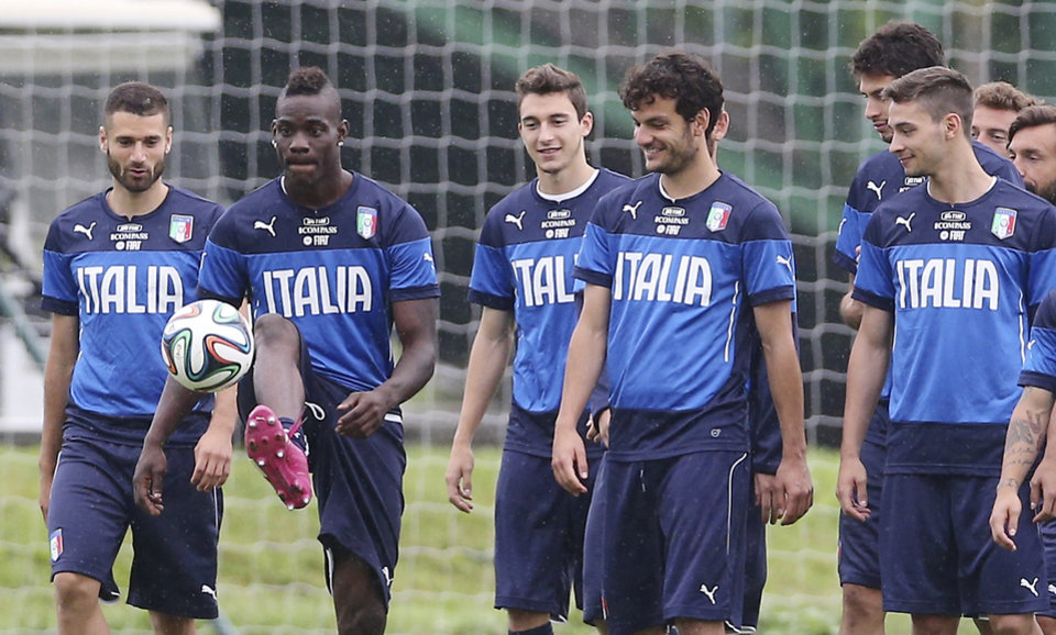 Photo - Italy's Mario Balotelli, second from left, controls the ball during a training session in Mangaratiba, Brazil, Tuesday, June 10, 2014. Italy plays in group D of the 2014 soccer World Cup. (AP Photo/Antonio Calanni)