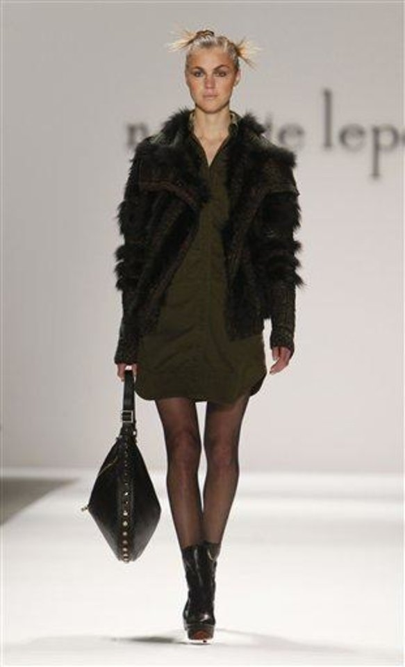 Photo -  The Nanette Lepore Fall 2013 collection is modeled during Fashion Week, Wednesday, Feb. 13, 2013 in New York. (AP Photo/Jason DeCrow)