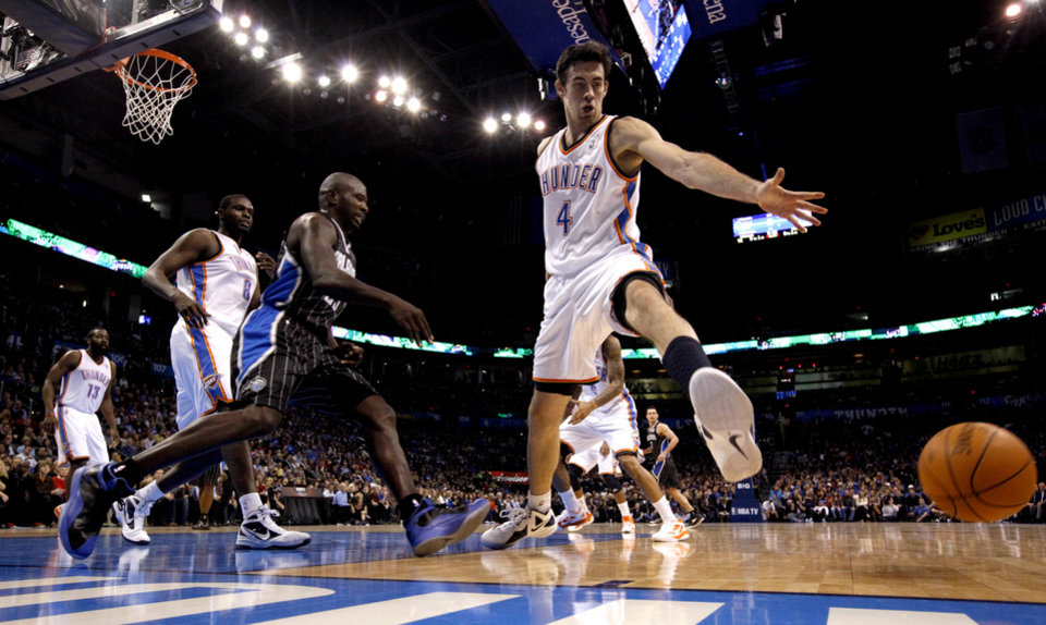 Oklahoma City Thunder's Nick Collison (4) tries to save a loose ball during the opening day NBA basketball game between the Oklahoma CIty Thunder and the Orlando Magic at Chesapeake Energy Arena in Oklahoma City, Sunday, Dec. 25, 2011. Photo by Sarah Phipps, The Oklahoman