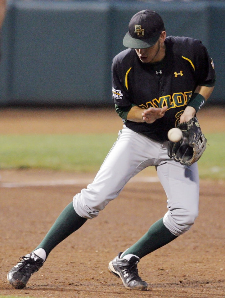 Baylor's Jake Miller fields the ball in the fifth inning during the Big 12 baseball championship tournament game between Baylor and Kansas at the Bricktown Ballpark in Oklahoma City, Saturday, May 29, 2010. Photo by Nate Billings, The Oklahoman