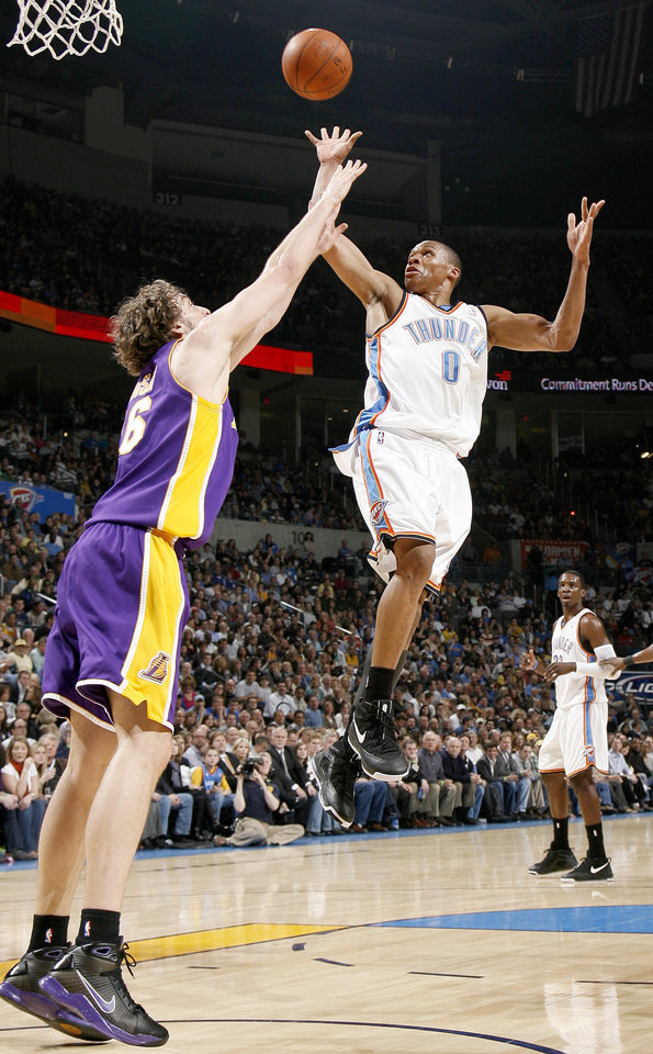 Oklahoma City's Russell Westbrook shots over Paul Gasol of the Lakers during the NBA basketball game between the Los Angeles Lakers and the Oklahoma City Thunder at the Ford Center,Tuesday, Feb. 24, 2009. PHOTO BY BRYAN TERRY, THE OKLAHOMAN