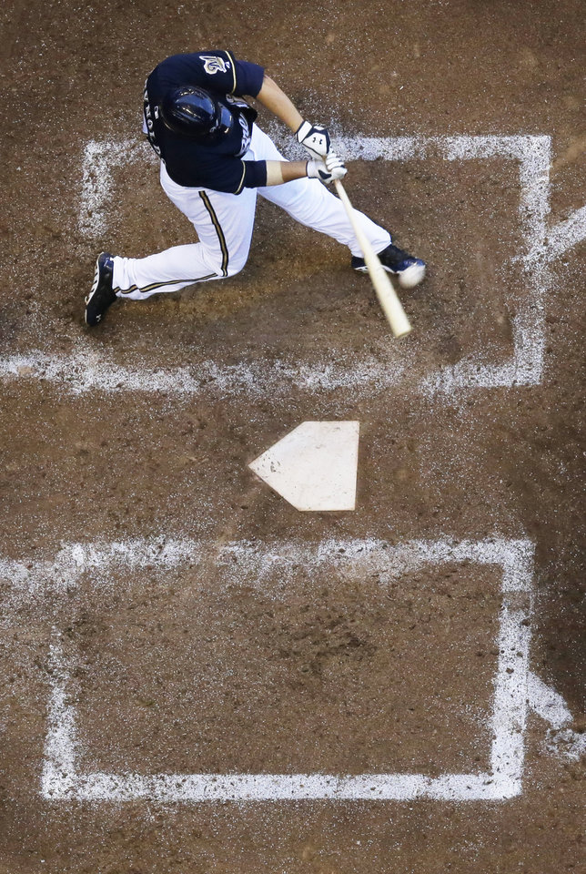 Photo - Milwaukee Brewers' Mark Reynolds hits a two-run home run during the sixth inning of a baseball game against the Cincinnati Reds Wednesday, July 23, 2014, in Milwaukee. (AP Photo/Morry Gash)
