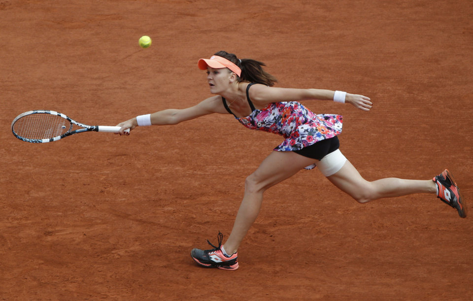 Photo - Poland's Agnieszka Radwanska returns the ball during the third round match of the French Open tennis tournament against Croatia's Ajla Tomljanovic at the Roland Garros stadium, in Paris, France, Friday, May 30, 2014.  (AP Photo/Michel Euler)