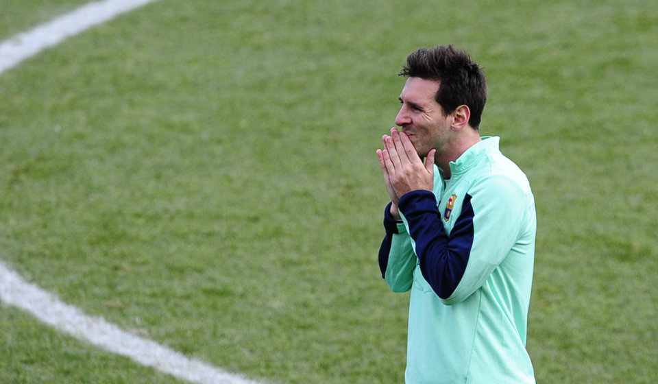 Photo - FC Barcelona's Lionel Messi, from Argentina, gestures during a training session at the Mini Stadi Stadium in Barcelona, Spain, Friday, Jan. 3, 2014. (AP Photo/Manu Fernandez)