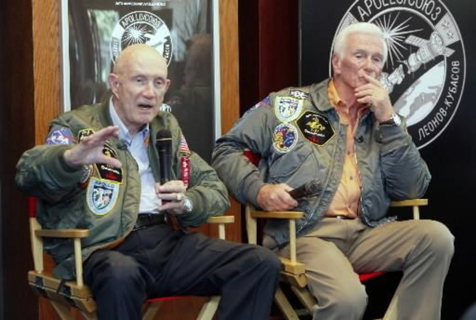 Photo - Apollo astronauts Tom  Stafford (left) and Gene  Cernan participate in a panel discussion at B.C. Clarks Jewelry store at Penn Square Mall in Oklahoma City, OK, Thursday, May 27, 2010. The astronauts talked about their missions and answered some questions from the public. By Paul Hellstern
