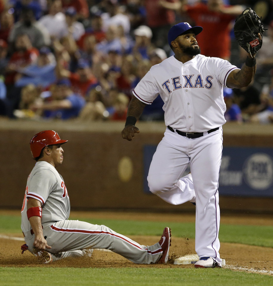 Photo - Texas Rangers first baseman Prince Fielder looks up at the ball in his glove after doubling off Philadelphia Phillies' Carlos Ruiz at first for a double play in the fifth inning of a baseball game, Tuesday, April 1, 2014, in Arlington, Texas. Ruiz was trying to get back to first after John Mayberry Jr. lined out to second. (AP Photo/Tony Gutierrez)