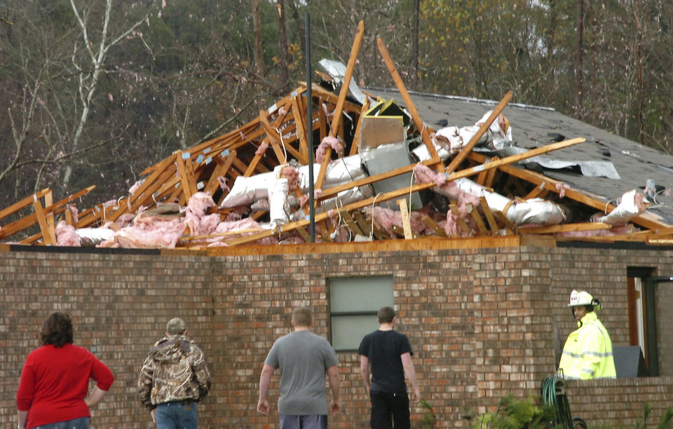 Photo - A house in Tioga, La., is severely damaged after an apparent tornado tore through the area Tuesday, Dec. 25, 2012. (AP Photo/The Daily Town Talk, Melinda Martinez)  NO SALES
