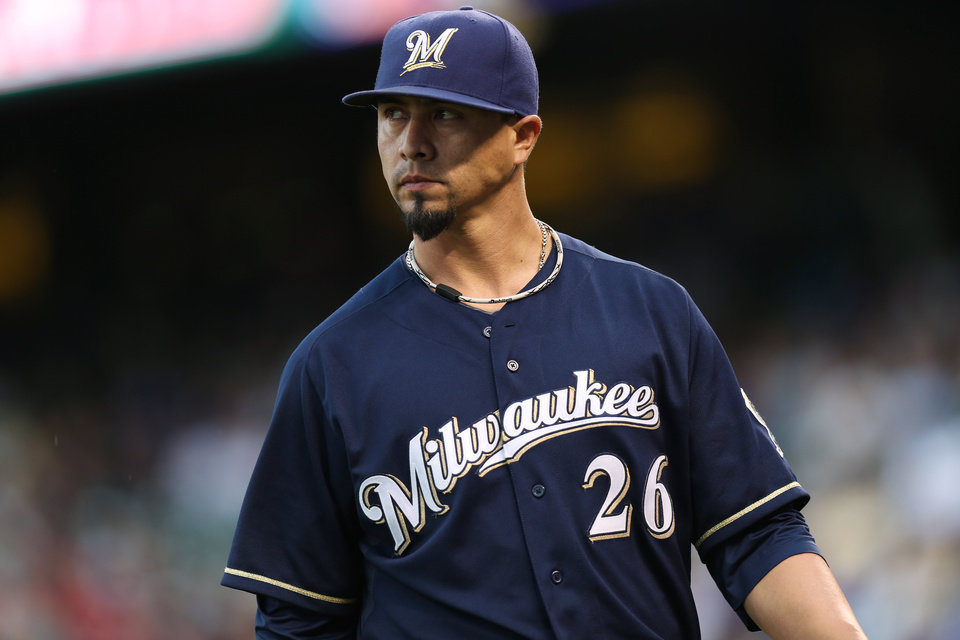 Photo - Milwaukee Brewers starting pitcher Kyle Lohse heads to the dugout after retiring the Colorado Rockies after giving up two runs in the third inning of a baseball game in Denver on Sunday, June 22, 2014. (AP Photo/David Zalubowski)