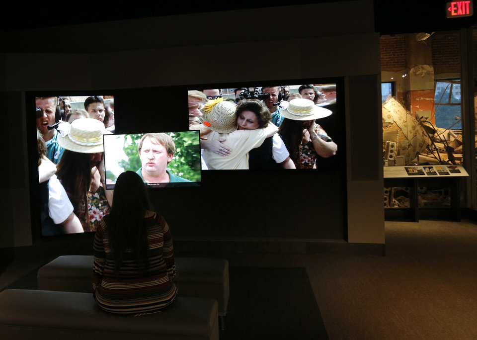 Photo - A visitor watches a video Sunday on the newly renovated second floor of the Oklahoma City National Memorial & Museum.  Photo by Sarah Phipps, The Oklahoman  SARAH PHIPPS -  SARAH PHIPPS