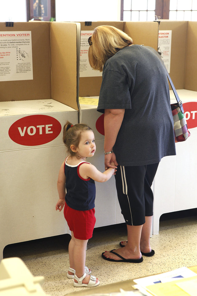 Photo - Camryn Kersh, 2, and her mom Brittany Kersch vote at Holy Trinity Lutheran Church in Edmond, Tuesday, July 27, 2010.    Photo by David McDaniel, The Oklahoman