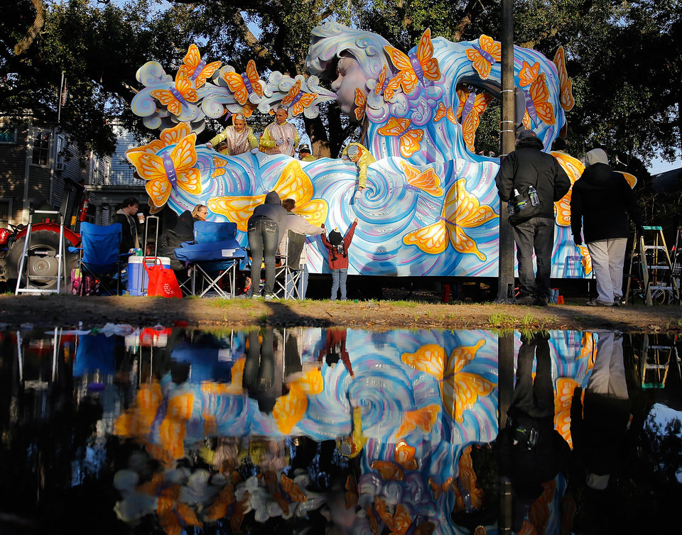 Photo - The Krewe of Proteus rolls uptown on Lundi Gras, Monday, March 3, 2014, in New Orleans. The 20-float parade depicted the theme