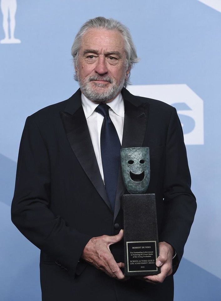 Photo - Robert De Niro poses in the press room with the lifetime achievement award at the 26th annual Screen Actors Guild Awards at the Shrine Auditorium & Expo Hall on Sunday, Jan. 19, 2020, in Los Angeles. [Photo by Jordan Strauss/Invision/AP]