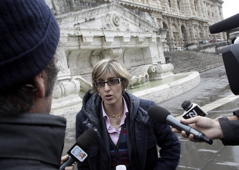 Photo - Giulia Bongiorno, lawyer of Amanda Knox's ex-boyfriend, Raffaele Sollecito, talks to reporters in front of the Italy's Court of Cassation, in Rome, Monday, March 25, 2013. Amanda Knox was waiting anxiously Monday to hear whether her ordeal is over or whether she will face trial again, as Italy's top criminal court considered whether to overturn her acquittal in the murder of her roommate. Prosecutors are asking the high court to throw out the acquittals of American Knox and her Italian ex-boyfriend in the murder of 21-year-old British student Meredith Kercher, and order a new trial. (AP Photo/Riccardo De Luca)