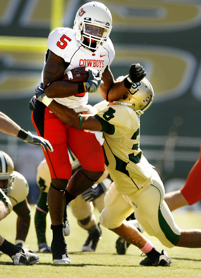 Photo - Keith Toston carries in the first half during the college football game between Baylor University and Oklahoma State University (OSU) at Floyd Casey Stadium in Waco, Texas, on Saturday, Oct. 24, 2009.  Photo by Steve Sisney, The Oklahoman