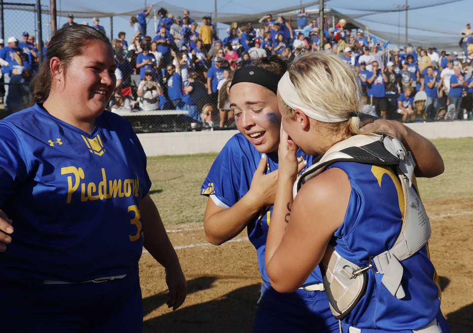 Photo - Piedmont #33 Chloe Bohuslavicky, #16 Cozee Clark and #25 Ellie Griffin during the 5A Fast Pitch Championship game between Piedmont and Carl Albert at the Ball Fields at Firelake in Shawnee, Saturday, October 19, 2019. [Doug Hoke/The Oklahoman]