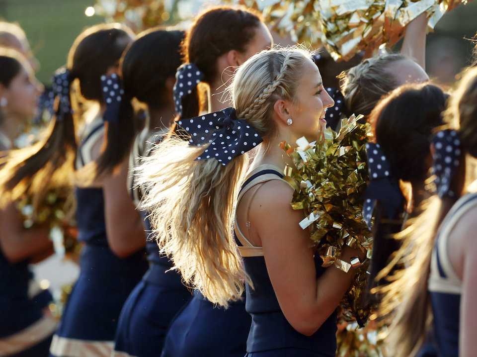 Photo - The Southmoore pom squad cheers during a high school football game between Southmoore and Carl Albert at Moore Schools Stadium in Moore, Okla., Thursday, Sept. 5, 2013.  Photo by Nate Billings, The Oklahoman