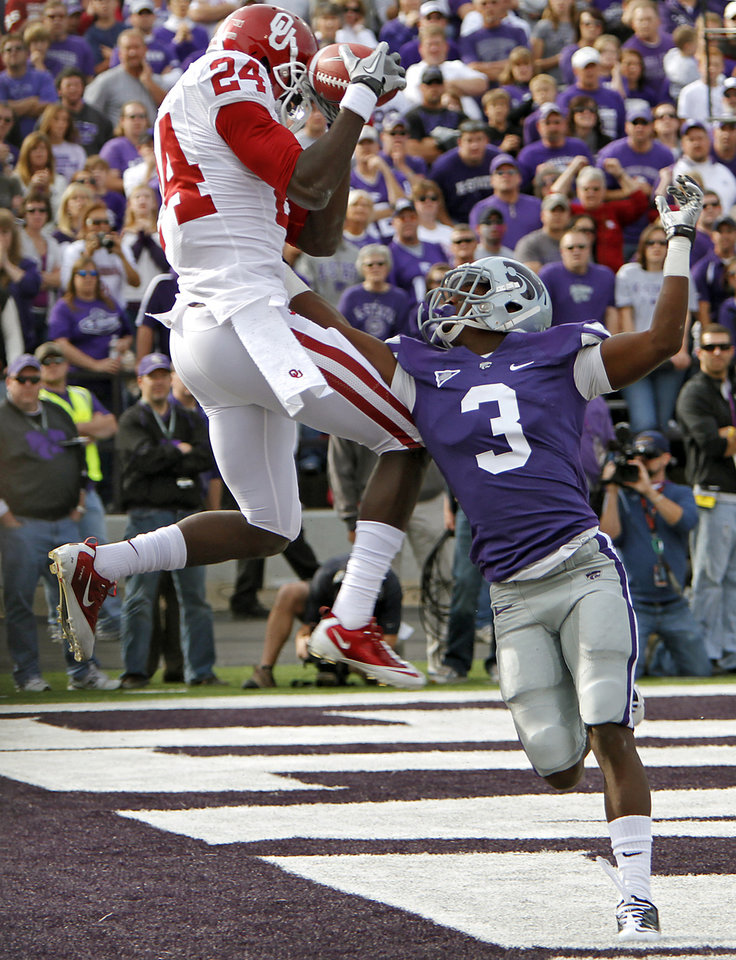 Oklahoma Sooners' Dejuan Miller (24) catches a touchdown over Kansas State Wildcats' Allen Chapman (3) during the college football game between the University of Oklahoma Sooners (OU) and the Kansas State University Wildcats (KSU) at Bill Snyder Family Stadium on Sunday, Oct. 30, 2011. in Manhattan, Kan. Photo by Chris Landsberger, The Oklahoman  ORG XMIT: KOD