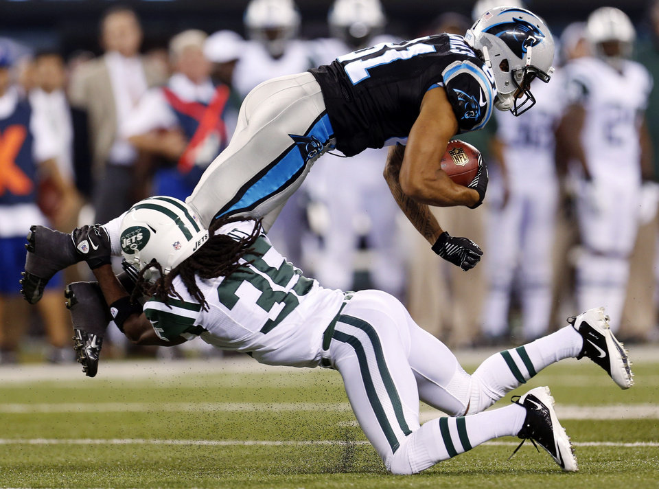 Photo -   Carolina Panthers wide receiver Kealoha Pilares (81) is tackled by New York Jets cornerback Isaiah Trufant (35) during the first half of a preseason NFL football game, Sunday, Aug. 26, 2012, in East Rutherford, N.J. (AP Photo/Julio Cortez)