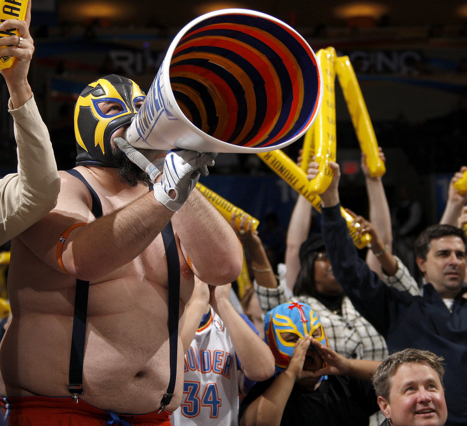 Photo - Oklahoma City Thunder fan Garrett Haviland cheers during the NBA basketball game between the Oklahoma City Thunder and the Golden State Warriors at the Oklahoma City Arena, Tuesday, March 29, 2011. Photo by Bryan Terry, The Oklahoman