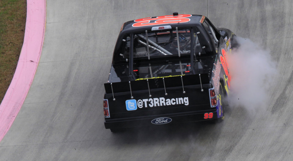 Photo -   Bryan Silas (99) trails smoke in turn two during the NASCAR truck race at Martinsville Speedway in Martinsville, VA., Saturday, Oct. 27, 2012. (AP Photo/Steve Helber)
