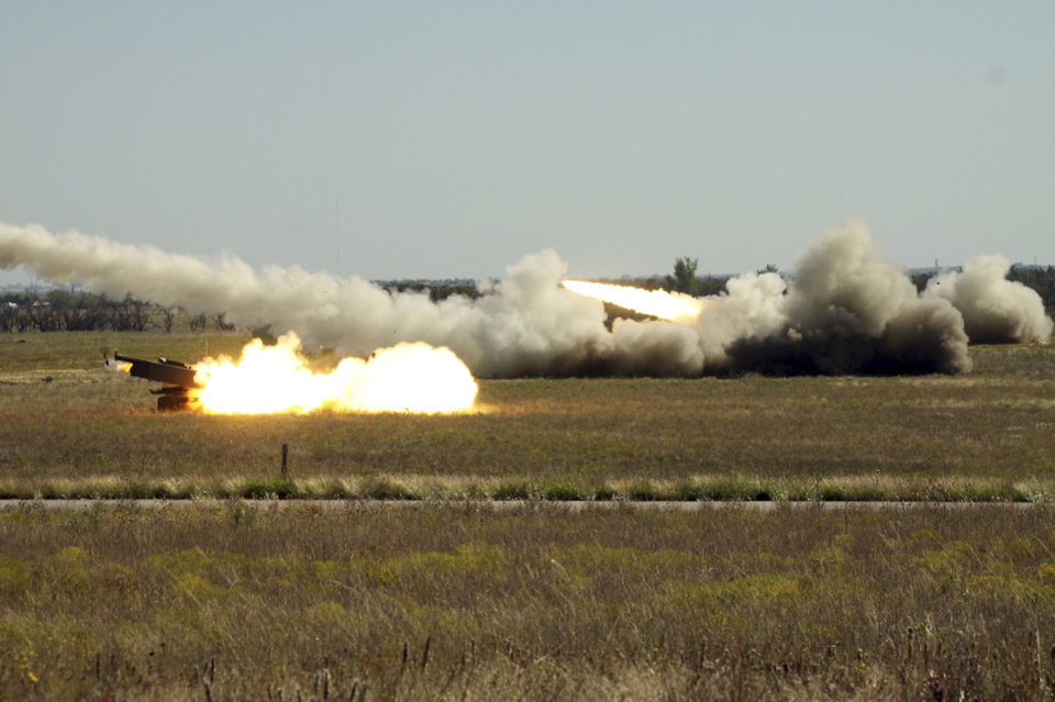 Photo - Above: Three Singaporean Armed Forces High Mobility Artillery Rocket System launchers fire almost simultaneously on Fort Sill's range Tuesday during Operation Daring Warrior. Because of Singapore's tiny size, the island nation's military can't fire the rocket systems unless it comes to an installation like Fort Sill.
