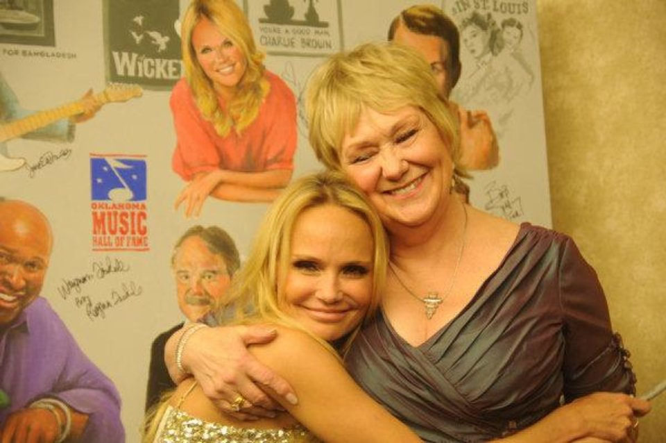 Photo - Singer and actress Kristin Chenoweth hugs Billie Sue Thompson who was accepting the induction into the Oklahoma Music Hall of Fame on behalf of Ralph Blane, a lyricist and performer from Broken Arrow. Thompson was Chenoweth's teacher at Broken Arrow High School. Photo by Adam Kemp, For The Oklahoman.  Adam Kemp - Oklahoman