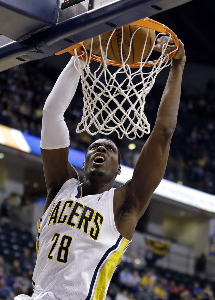 Photo - Indiana Pacers center Ian Mahinmi dunks in the second half of an NBA basketball game against the Denver Nugget in Indianapolis, Monday, Feb. 10, 2014. The Pacers won 119-80. (AP Photo/Michael Conroy)