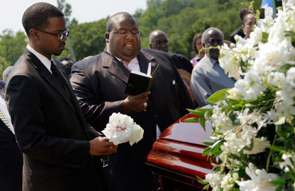 Photo -  Rev. A. Byron Coleman, middle, speaks next to Colin Boldien, a Luper family friend, during the graveside memorial service for civil rights activist Clara Luper at the Hillcrest Memorial Gardens cemetery in Spencer, Okla., Friday, June 17, 2011.  Luper was 88 years old when she died on June 8, 2011. Photo by Nate Billings, The Oklahoman