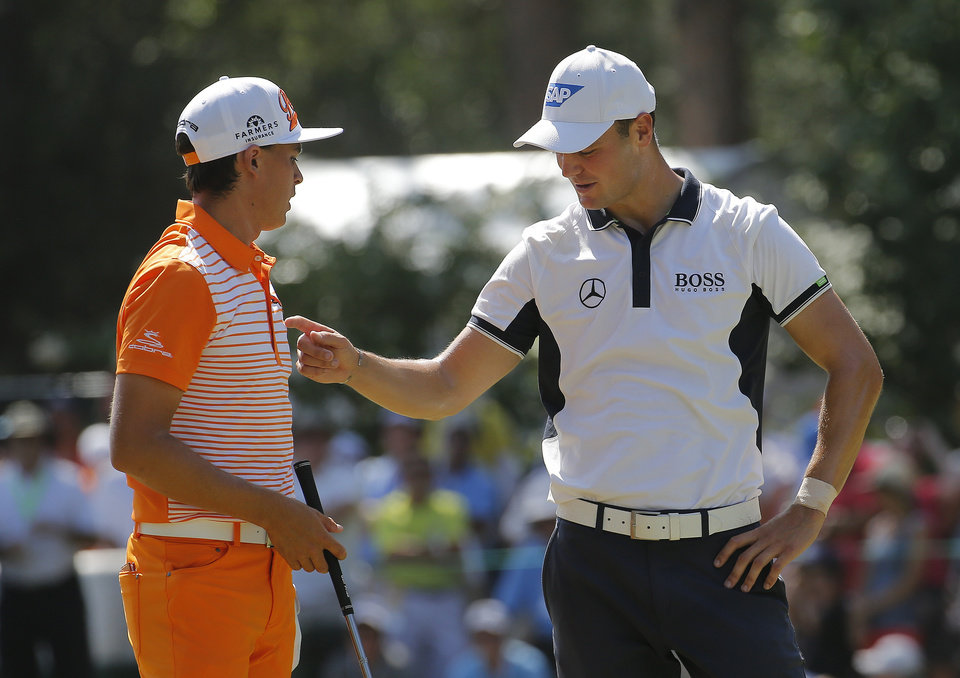 Photo - Martin Kaymer, of Germany, right, speaks with Rickie Fowler on the third hole during the final round of the U.S. Open golf tournament in Pinehurst, N.C., Sunday, June 15, 2014. (AP Photo/Matt York)